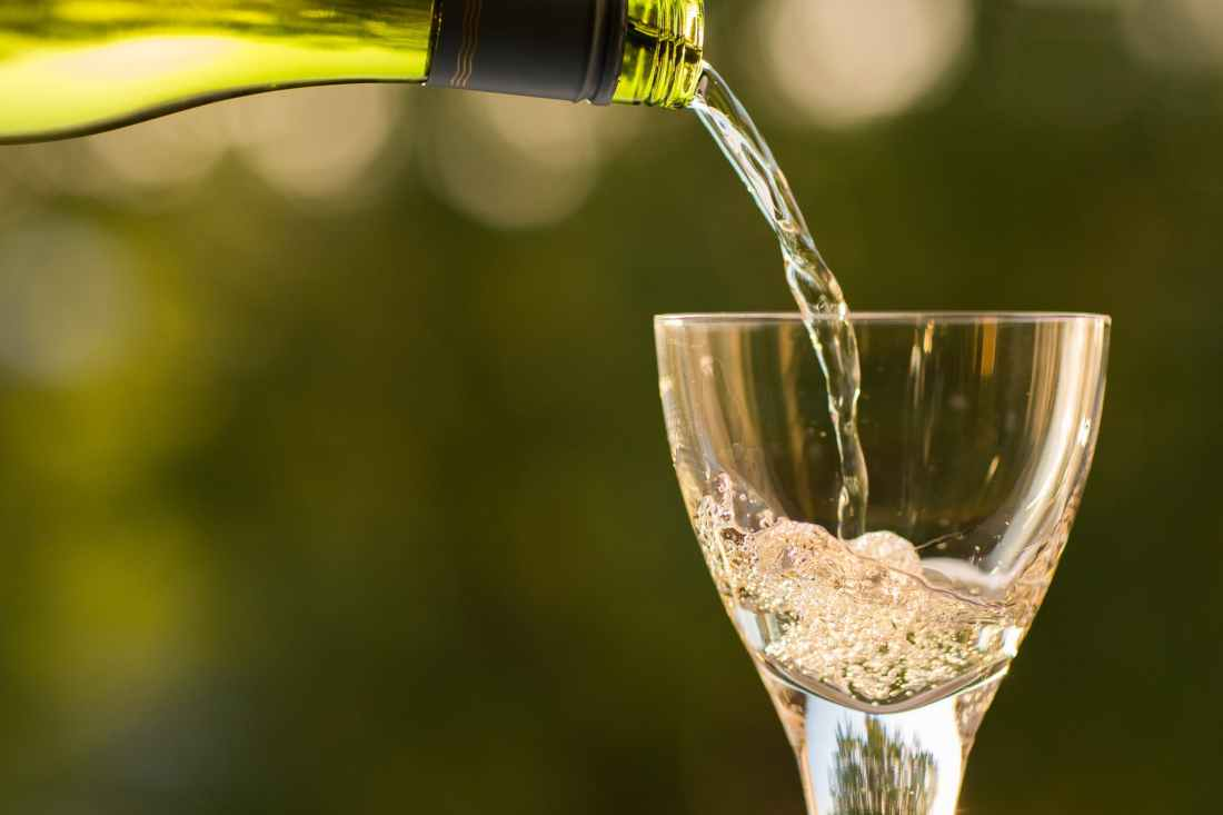 bottle pouring summertime wine glass